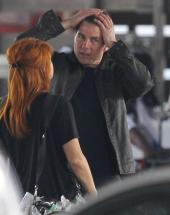 "Tom Cruise fixes his hair on the set of his new movie ""Jack Reacher: Never Go Back."""