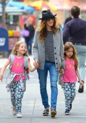 Sarah Jessica Parker and her twin daughters rocked matching outfits out in SoHo.