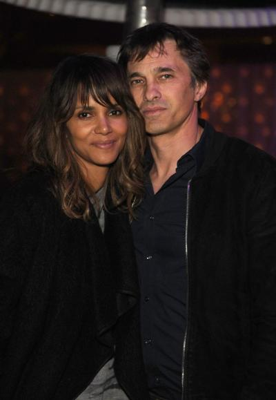 Halle Berry (L) says she's doing Ok after breaking up with Olivier Martinez (R) early last week.